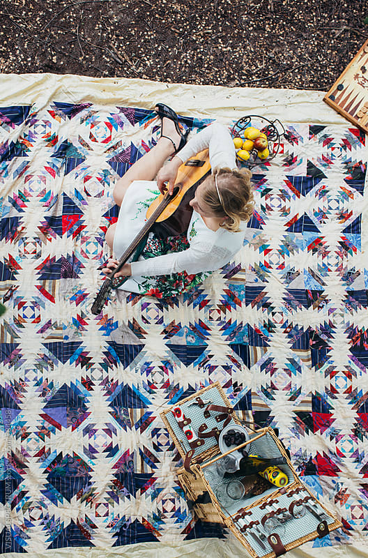 Retro Spring Outing - Overhead of Blond Woman Playing Guitar on Patchwork Blanket by Julien L. Balmer for Stocksy United