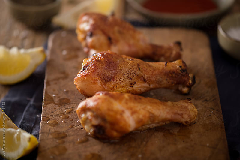 Roasted Crispy Chicken Drumsticks  by Studio Six for Stocksy United