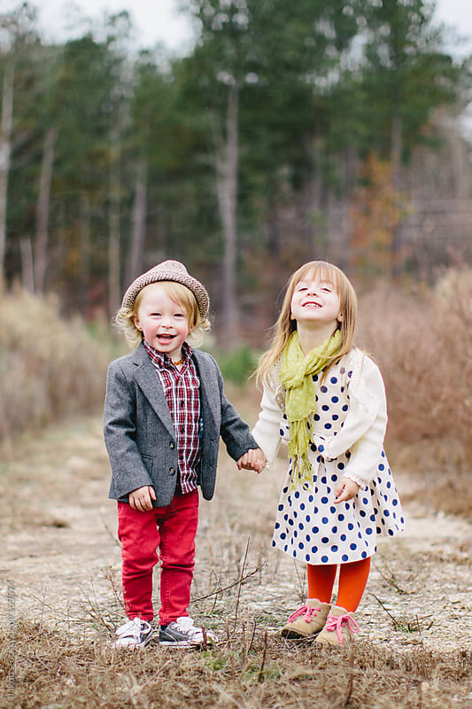 Trendy and cute children holding hands outside by Jakob for Stocksy United