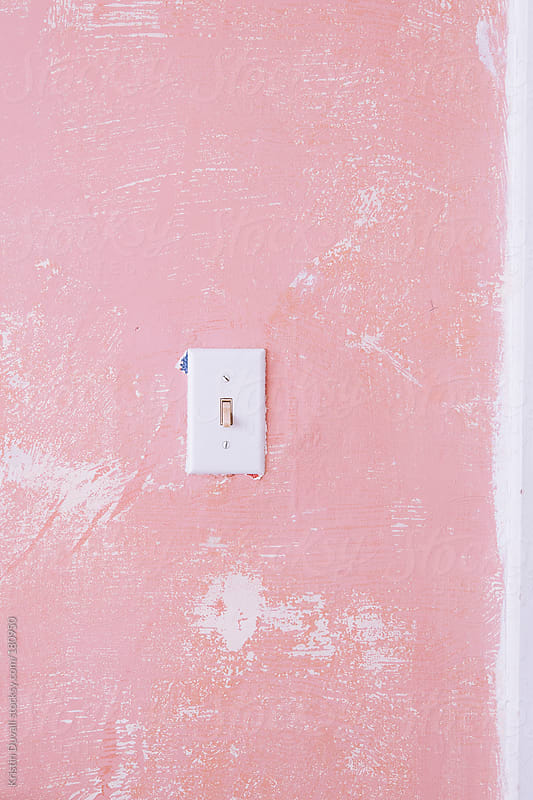 Light switch on pink wall by Kristin Duvall for Stocksy United