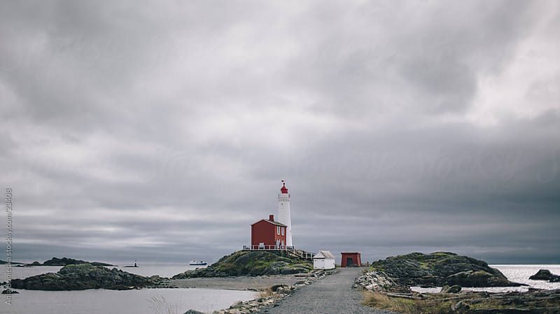 Lighthouse on a stormy day by Ania Boniecka for Stocksy United