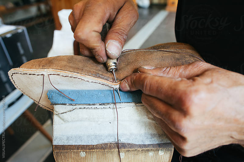 Close Up of Shoemaker Fixing Shoe Sole by Julien L. Balmer for Stocksy United