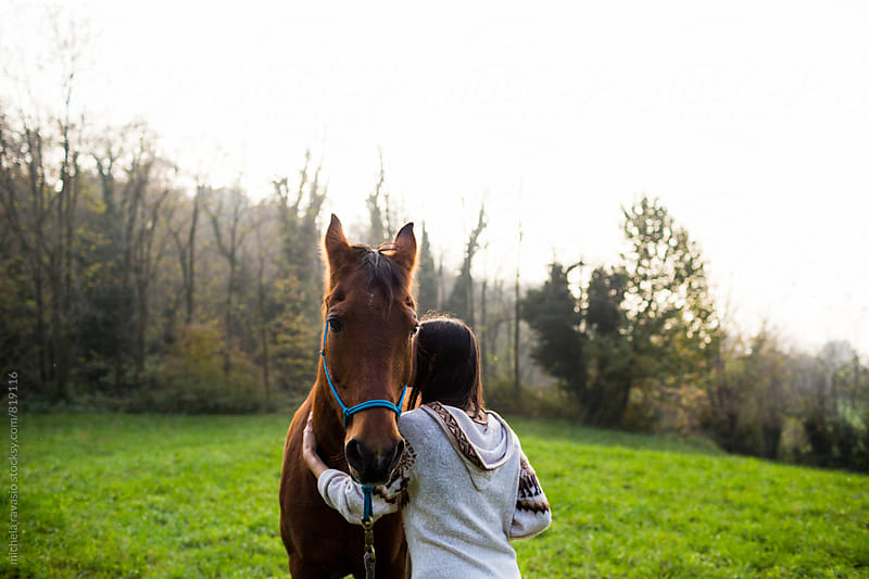 Young woman embracing her horse by michela ravasio for Stocksy United