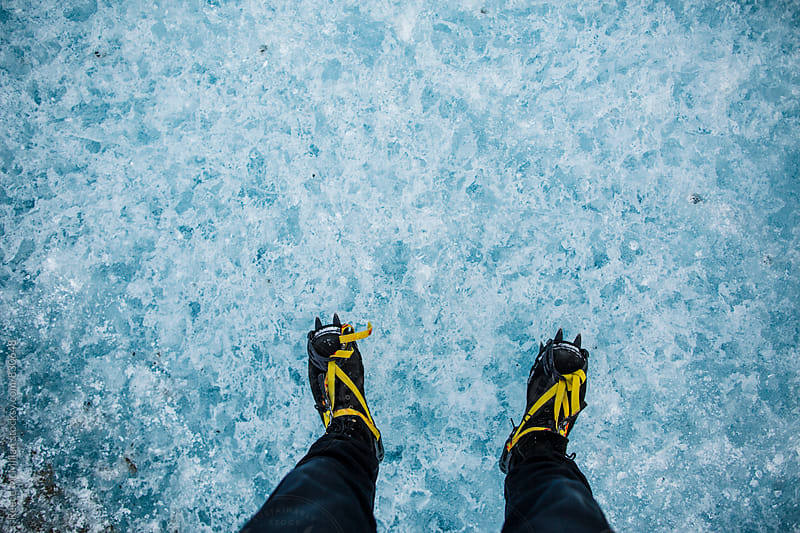 Feet on the ice by Reece McMillan for Stocksy United