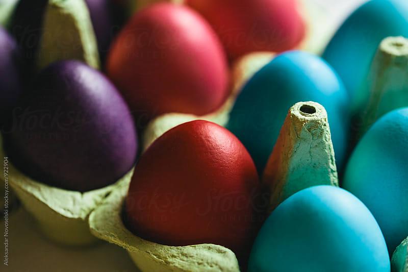 Colored Easter eggs in carton by Aleksandar Novoselski for Stocksy United