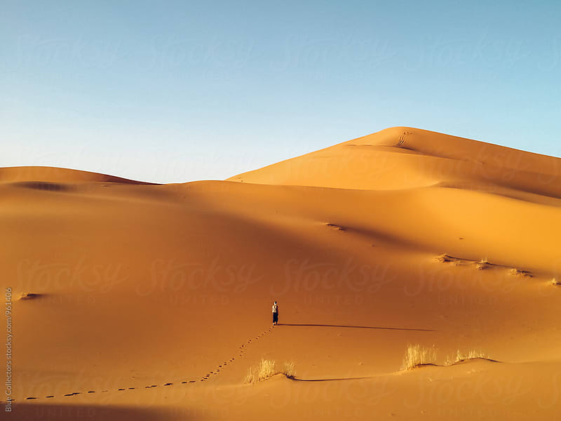 Woman walk into the Desert dunes landscape by Blue Collectors for Stocksy United