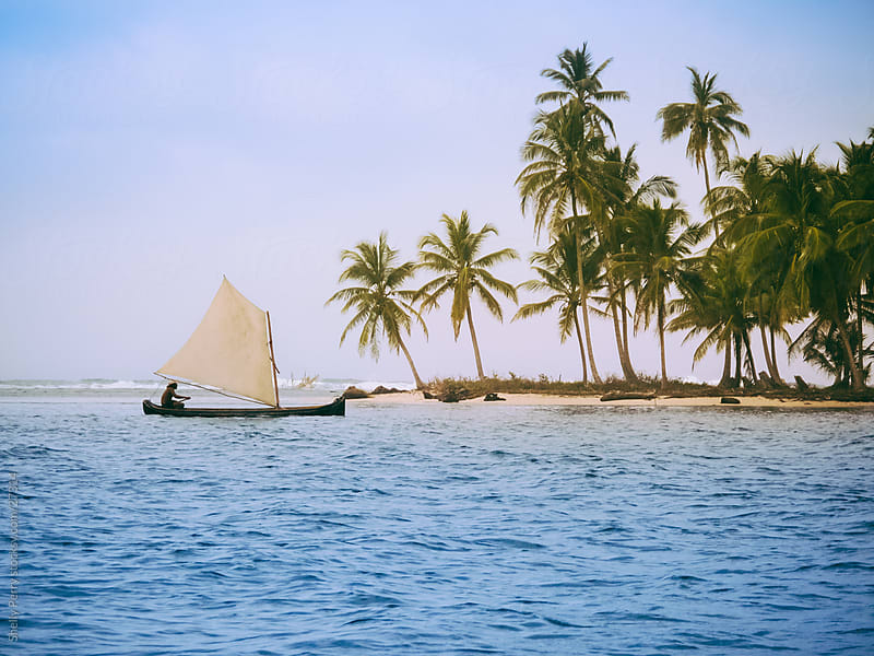 Traditional sailing at the palm covered islands of San Blas, Panama by Shelly Perry for Stocksy United