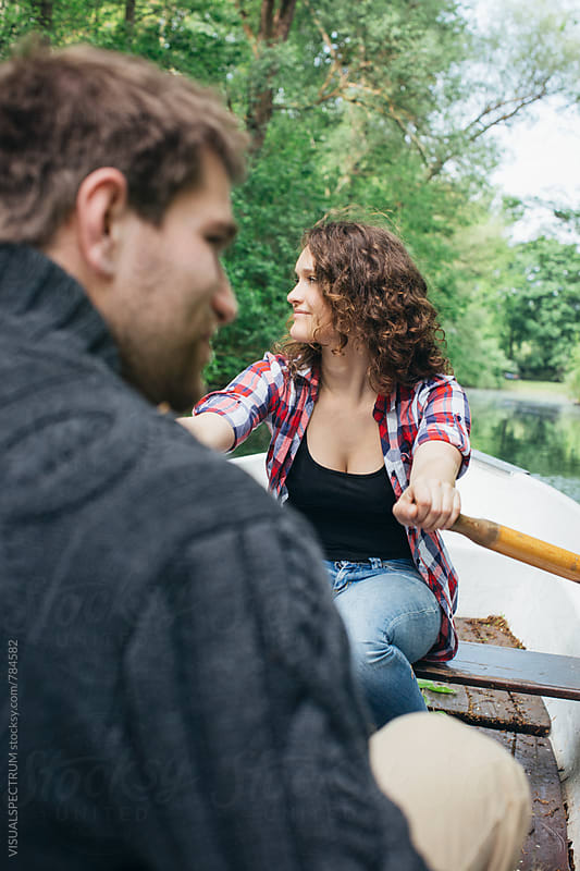 Young Caucasian Couple on Rowboat on Forest Lake by Julien L. Balmer for Stocksy United