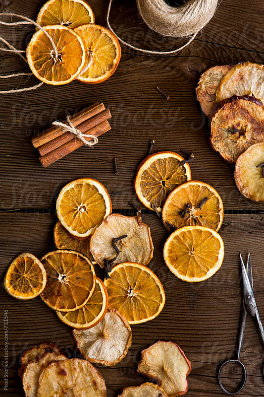 Fragrant homemade orange Christmas wreath ingredients by Pixel Stories for Stocksy United