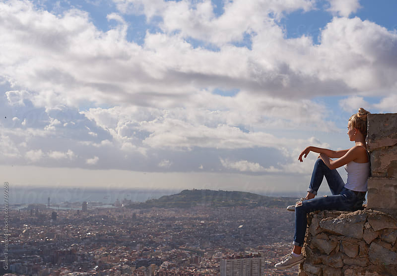 blonde woman enjoying views of Barcelona by Guille Faingold for Stocksy United