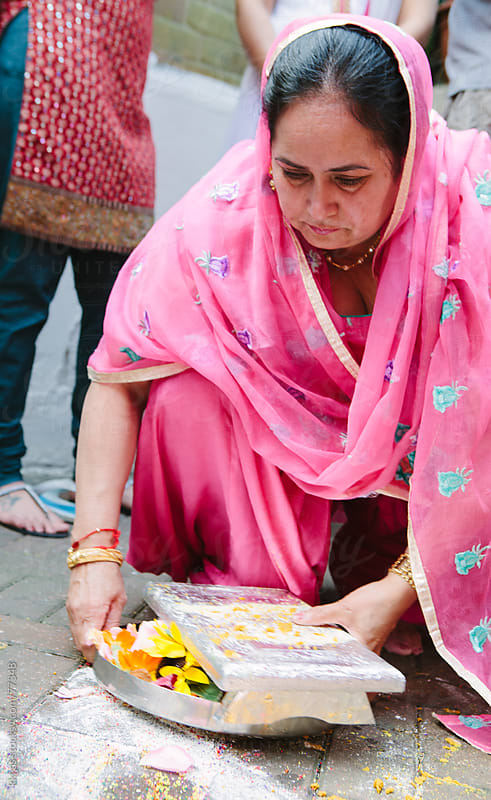 Collecting the Rangoli during Mayian ceremony of Sikh wedding by kkgas for Stocksy United