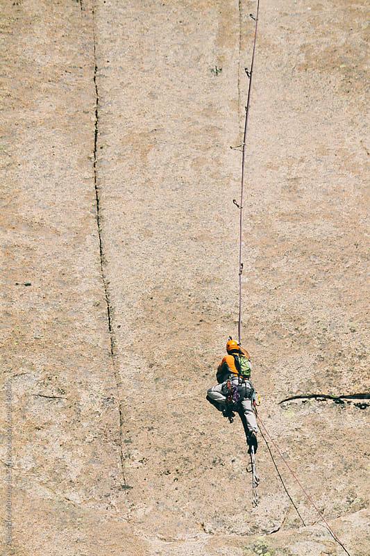 Climber climbing on big rock wall. Slab climbing in Pedriza, Madrid, Spain by Alejandro Moreno de Carlos for Stocksy United