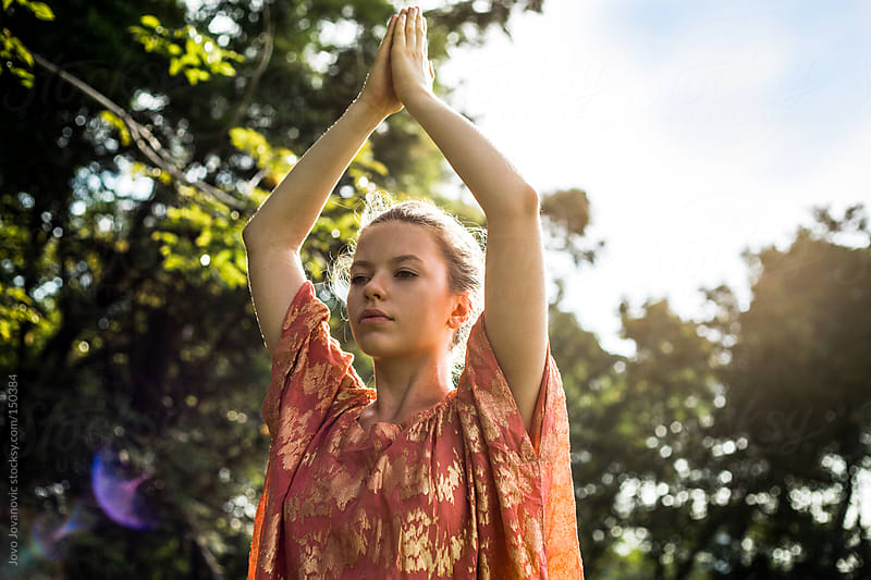 Young woman doing yoga in park. by Jovo Jovanovic for Stocksy United