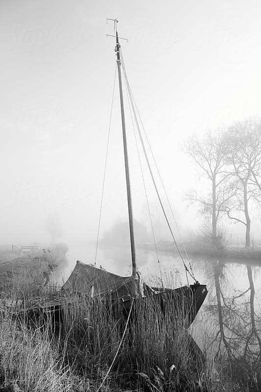 Sailingboat in foggy river by Marcel for Stocksy United