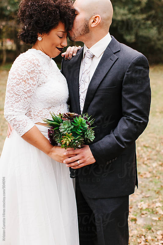 Bride and groom on their special day.  by Kristen Curette Hines for Stocksy United
