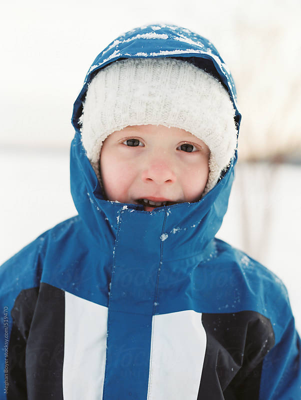 Cute little boy dressed and ready to play in the fresh snow by Meghan Boyer for Stocksy United