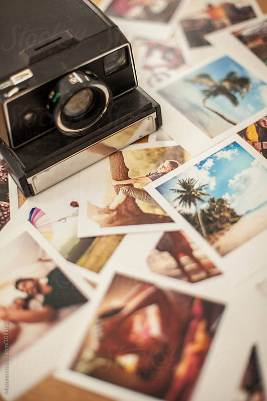 Polaroid Camera and Photos on the Table by Mosuno for Stocksy United