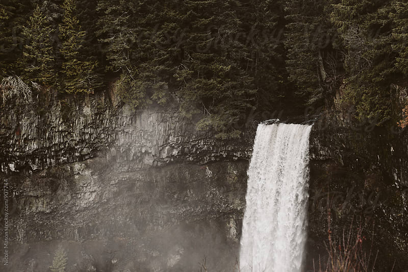 waterfall on overcast day by Nicole Mason for Stocksy United