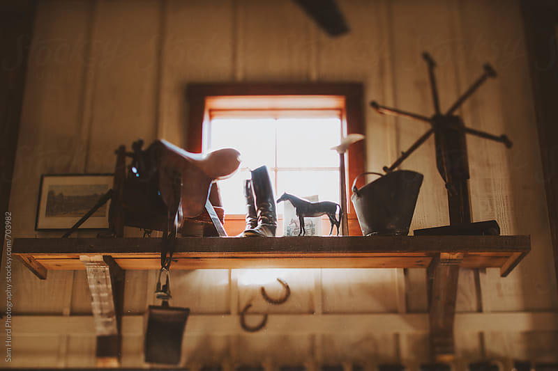 old fashion decorations on shelf in cabin by Sam Hurd Photography for Stocksy United