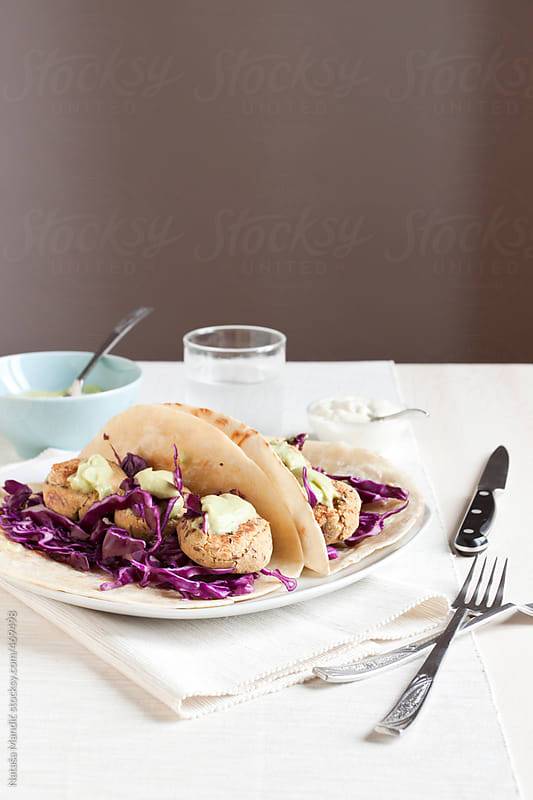 Homemade tacos with cabbage slaw, chickpea patties and sauce by Nataša Mandić for Stocksy United