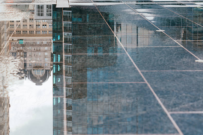 Wet ground in the city center by Good Vibrations Images for Stocksy United