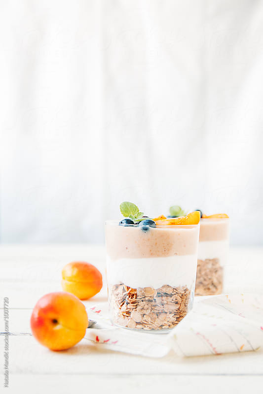 Delicious breakfast with apricots and bluberries by Nataša Mandić for Stocksy United