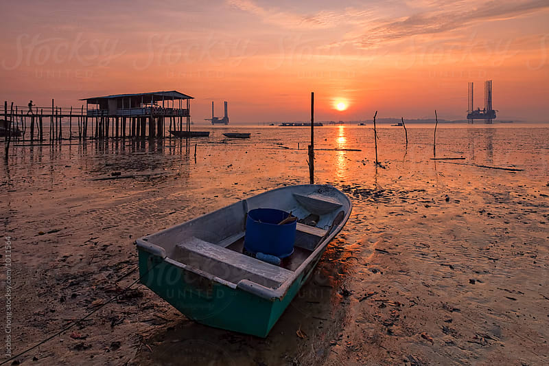 Low tide and sunrise by Jacobs Chong for Stocksy United