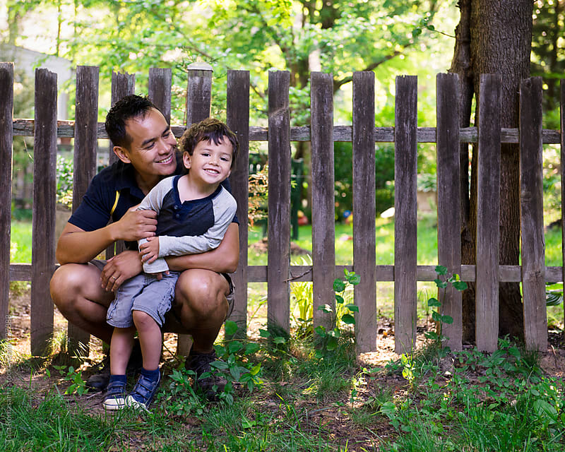 dad playing with child by Tara Romasanta for Stocksy United