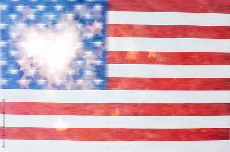 Sparklers shaping a heart in front of American flag by Beatrix Boros for Stocksy United