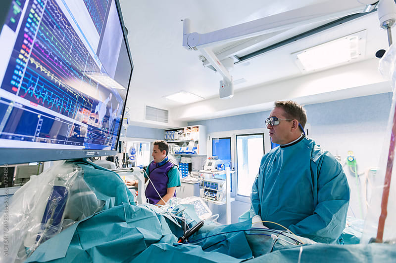 Doctor Operating Using Robot-Assisted Surgery by Victor Torres for Stocksy United