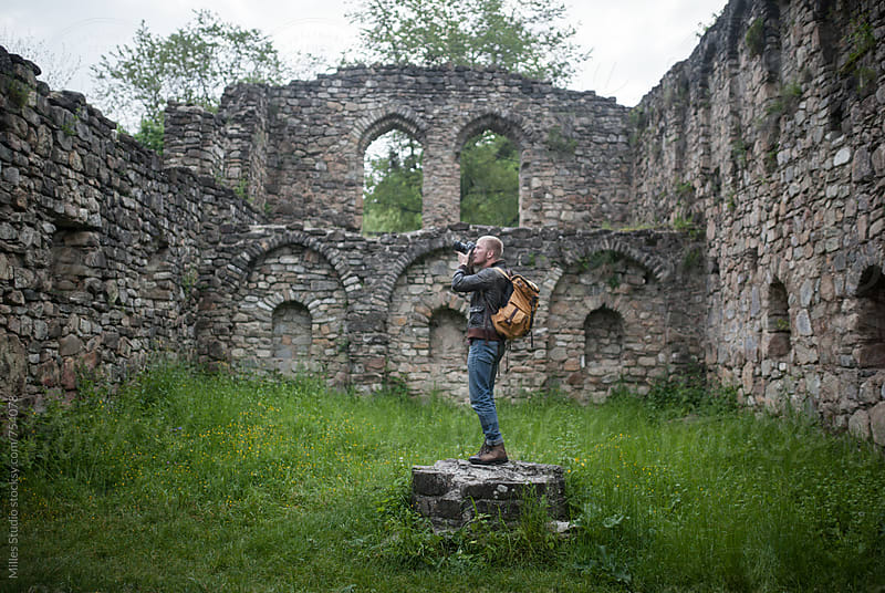 Photographer shooting ruins by Milles Studio for Stocksy United