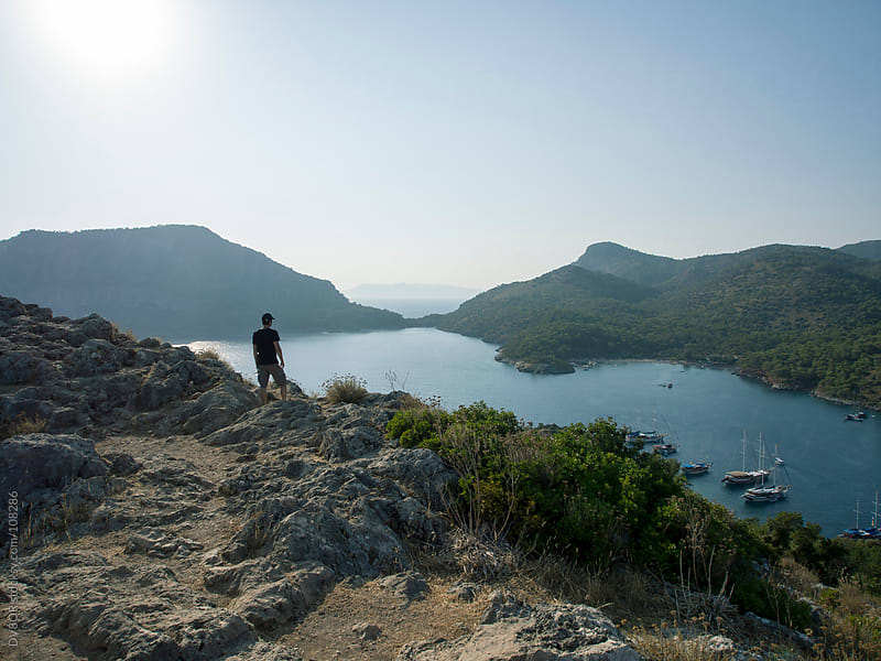 Man standing overlooking a bay in Turkey by DV8OR for Stocksy United
