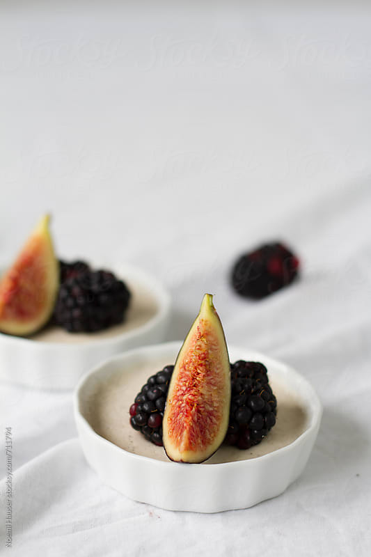 Panna cotta with fig and blueberry by Noemi Hauser for Stocksy United