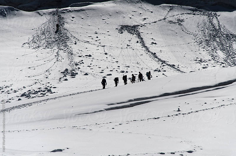 Alpinists on mountain glacier by Neil Warburton for Stocksy United