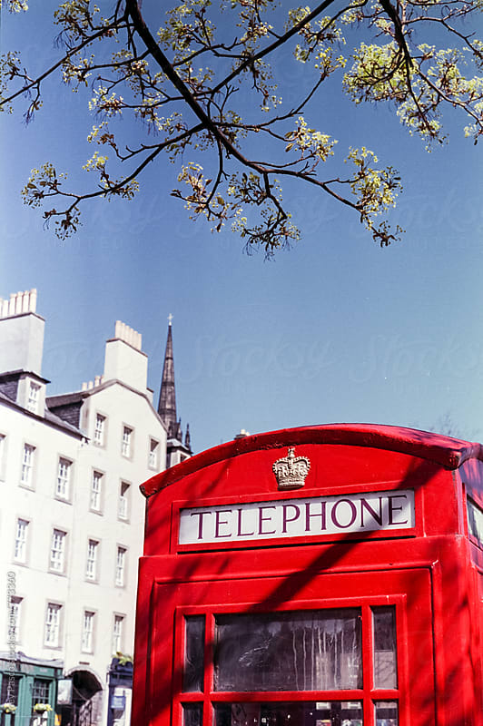 Red UK telephone booth in Edinburgh by Joey Pasco for Stocksy United