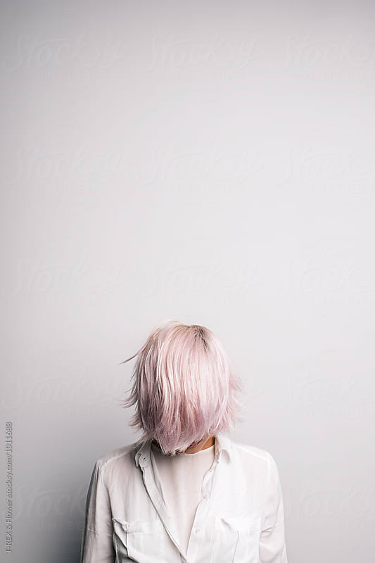 Pink-haired girl with covered face. by Danil Nevsky for Stocksy United