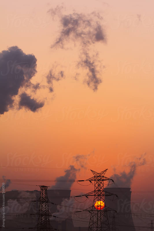 Thermal power plant when sunrise,Beijing by zheng long for Stocksy United