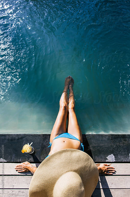 Woman Relaxing by Swimming Pool by VISUALSPECTRUM for Stocksy United