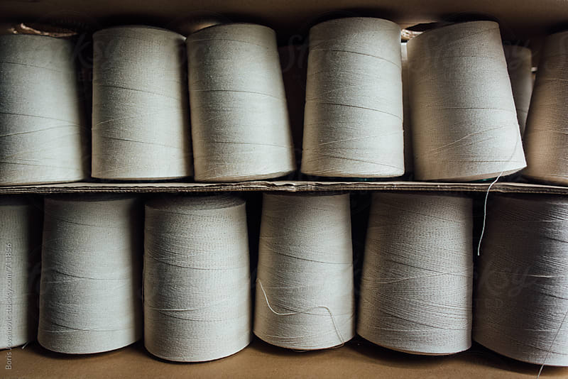 Silk rolls ready for shipping by Boris Jovanovic for Stocksy United
