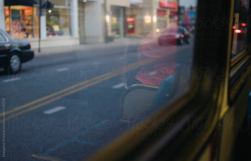 view from a city bus by Margaret Vincent for Stocksy United
