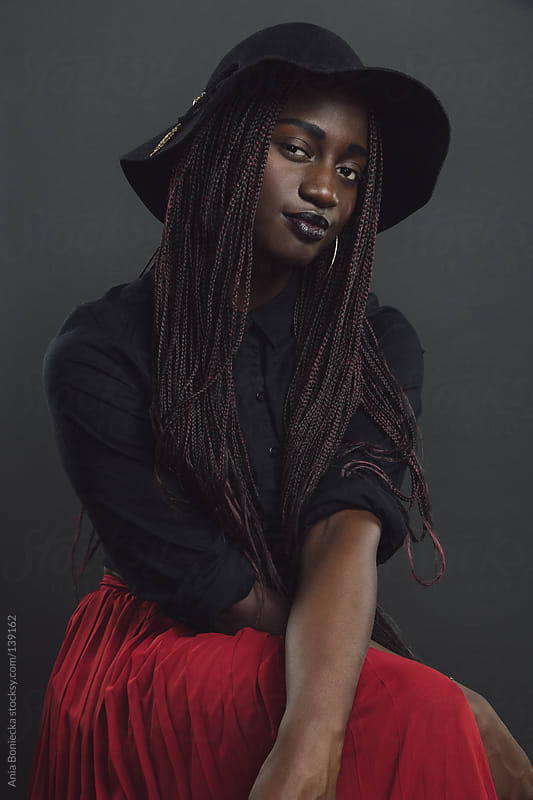 A portrait of a young black woman by Ania Boniecka for Stocksy United