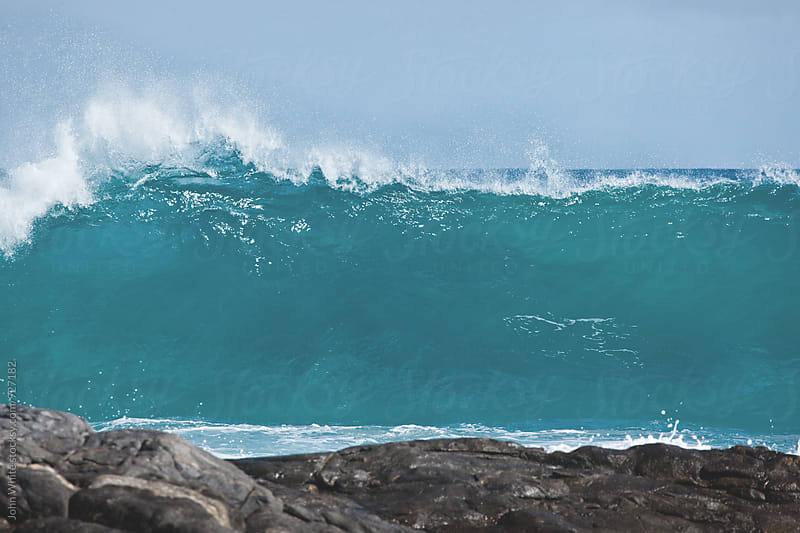 A wave breaking by John White for Stocksy United