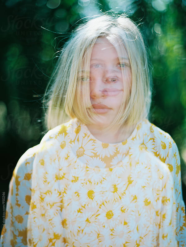 double exposure of blonde girl with bob and yellow dress by wendy laurel for Stocksy United