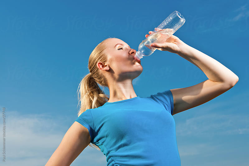 Hydration during physical training by Paul Schlemmer for Stocksy United