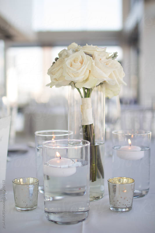 White bouqet in a glass vase by ZOA PHOTO for Stocksy United