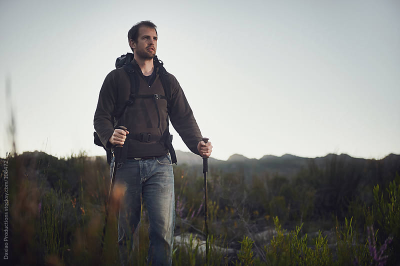 Trekking man by Daxiao Productions for Stocksy United