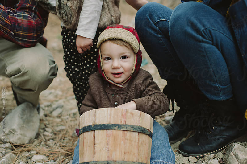 Toddler boy happy with bucket by Kristin Rogers Photography for Stocksy United