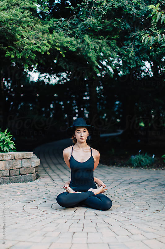 Healthy young woman meditating in full lotus position by Jakob for Stocksy United