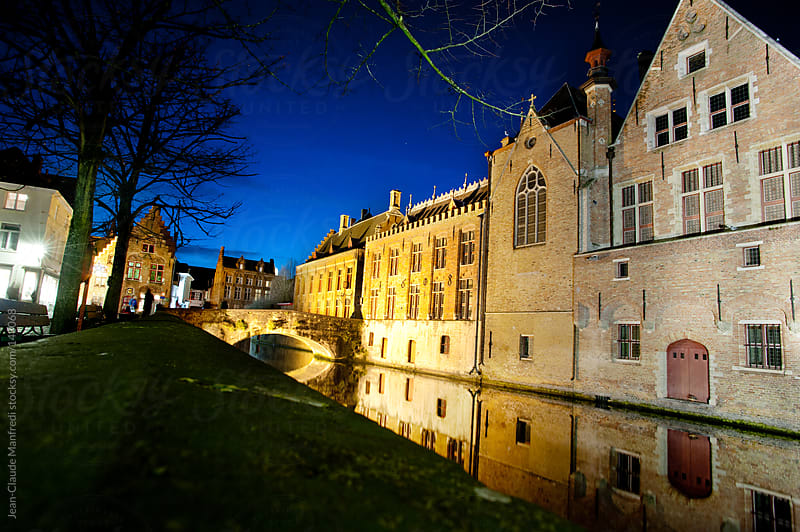 View of Bruges at night, UNESCO World Heritage Site. With canal and gothic flamish buildings by Jean-Claude Manfredi for Stocksy United