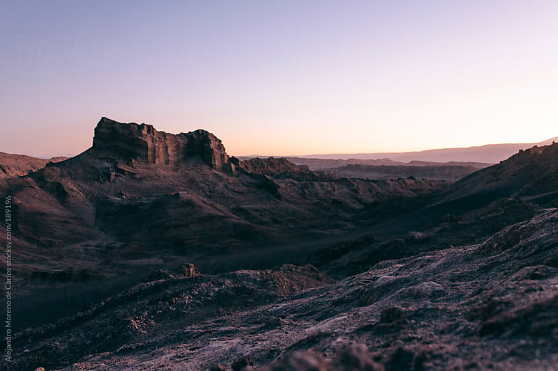 Rocky desert landscape at sunset by Alejandro Moreno de Carlos for Stocksy United